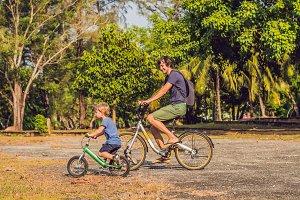 Happy family is riding bikes