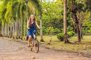young beautiful woman riding a