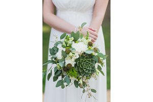 Wedding bouquet in hands of the