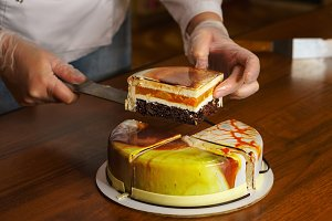 Confectioner cuts dacquoise cake