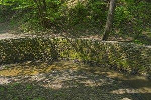 Bending reinforced creek bed