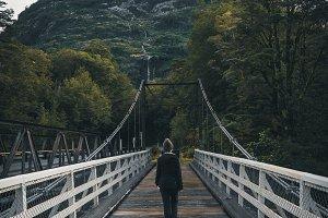 Person walking on a bridge view