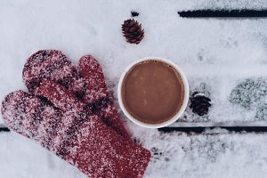 Cup of coffee and red mittens