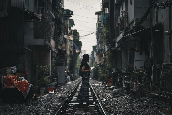 Woman standing on a train track