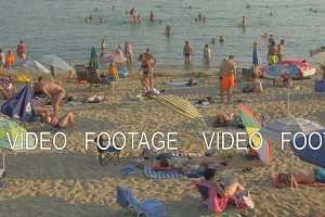 Vacationers relaxing at beach and