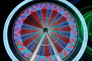 Colorful ferris wheel in motion