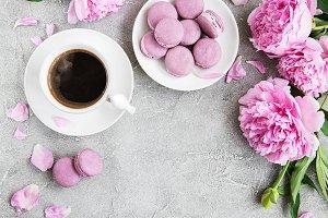 Pink peony with coffee and macarons