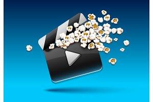 Cinema clapper with popcorn film.