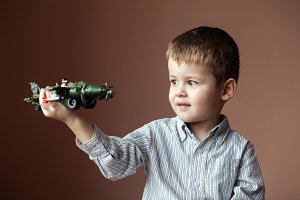 Cute little boy playing with a toy a