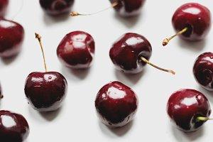Deep Red Cherries on White