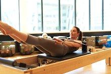 Brunette Woman Practicing Pilates in Studio.jpg