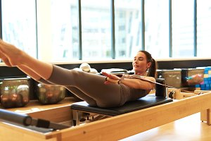 Brunette Woman Practicing Pilates in Studio.jpg