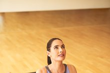 Athletic Woman Stretching her Body on Yoga Mat.jpg