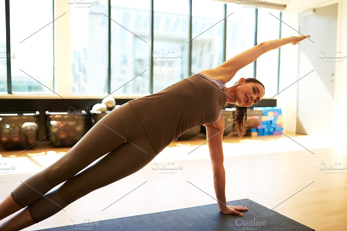 Fit pilates woman in studio.jpg - Sports