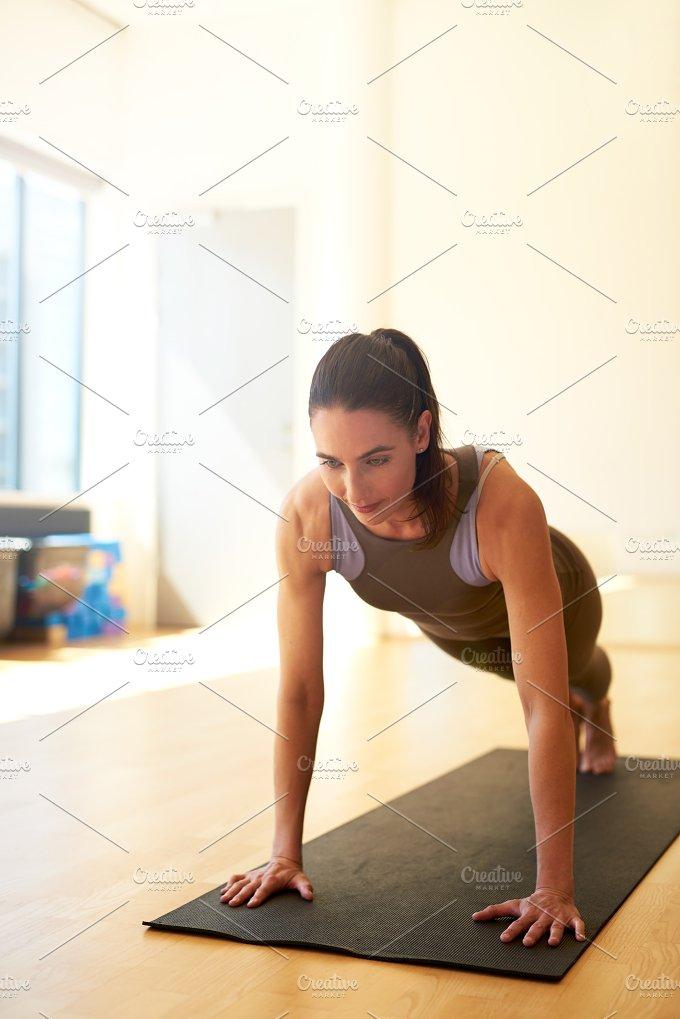 Fit woman doing push ups.jpg - Sports
