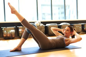 Fit woman in pilates class with ball.jpg