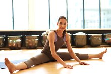 Fit woman is stretching on mat.jpg
