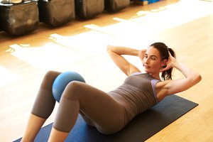 White woman doing pilates with ball.jpg