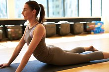Woman doing pilates in gym.jpg