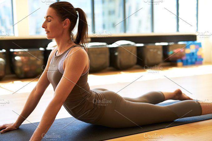 Woman doing pilates in gym.jpg - Sports