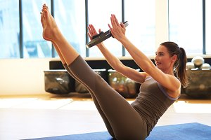 Woman is working out with pilates ring.jpg
