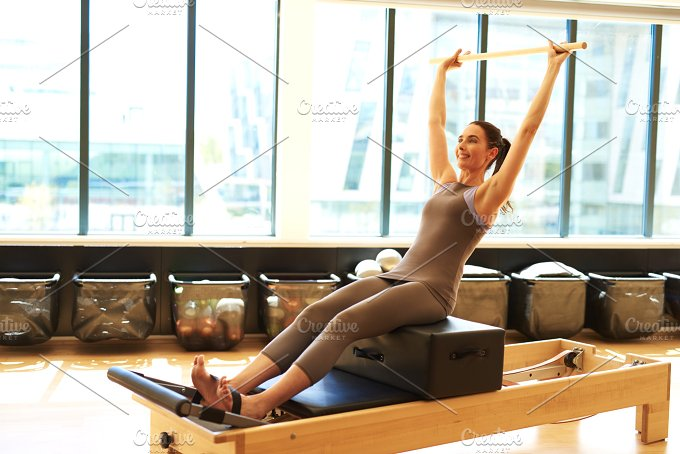 woman Practicing Pilates .jpg - Sports