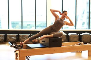 Woman Practicing Pilates in Studio.jpg