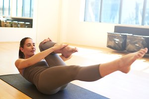 Woman Practicing Pilates on Floor Mat .jpg