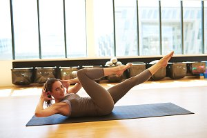 Woman Practicing Pilates on Floor Mat in Studio.jpg