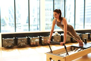 Woman Practicing Pilates on machine.jpg