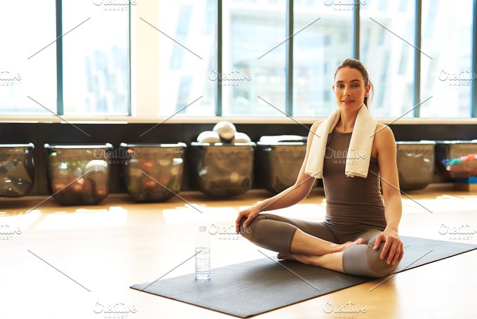 woman sitting on mat after workout.jpg - Sports