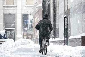 man on a bicycle in snow