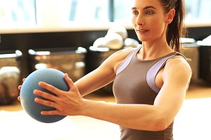 Woman training with pilates ball.jpg