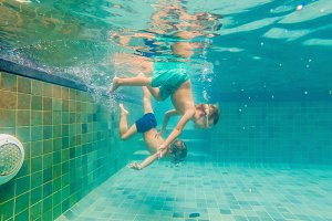 two children diving in masks