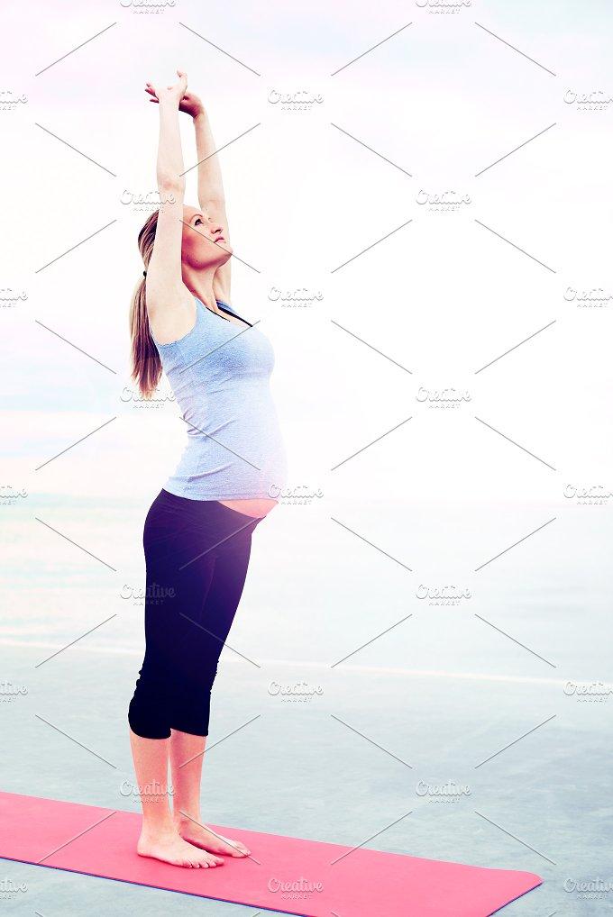 Pregnant woman doing aerobics exercises.jpg - People