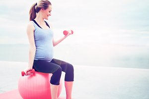 Pregnant woman doing fitness exercises.jpg