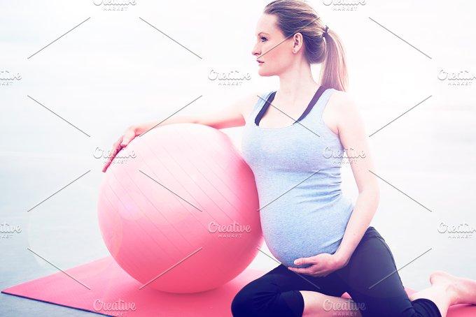 Pregnant woman doing pilates exercises.jpg - People