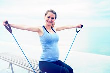 Pregnant woman exercising with ropes.jpg