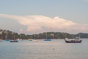 Sailboats in the bay against the