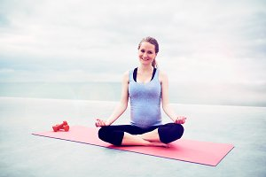 Pregnant woman sitting meditating.jpg