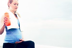 Pregnant woman taking a break from her exercise.jpg