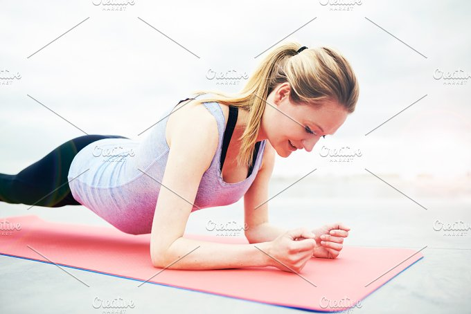 Smiling young woman working out during pregnancy.jpg - People