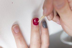 Closeup of Woman applying nail varni