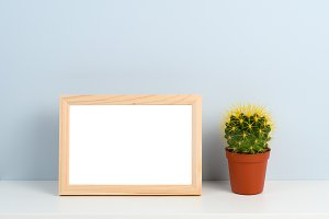 Wooden photo frame and cactus