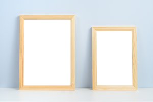 Two photo frames standing on shelf