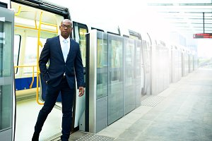Black American Businessman Going Out From a Train.jpg