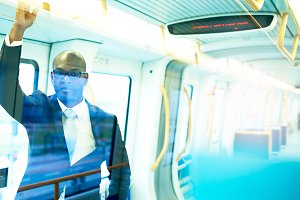 Businessman in a Train With Light Reflections.jpg