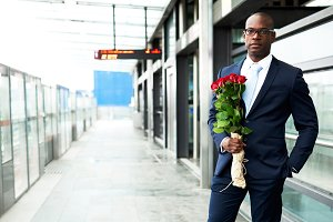 Businessman at Metro Holding Bouquet of Flowers.jpg