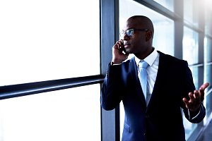 Businessman Talking on Phone Inside the Building.jpg