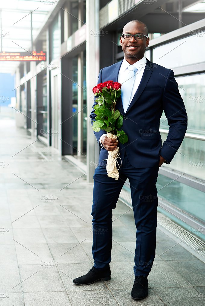 Happy Businessman Waiting at the Metro with Roses.jpg - People
